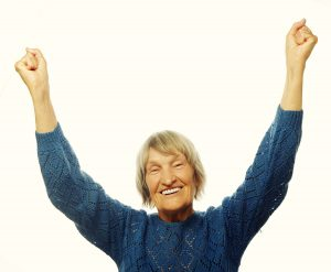 cheerful senior woman gesturing victory