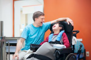 father-caring-for-disabled-son